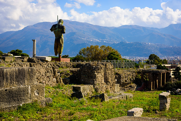 A modern statue guarding ancient Pompeii