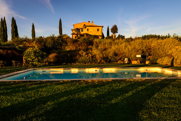 The farmhouse we stayed at in the Tuscan countryside and the pool behind it.