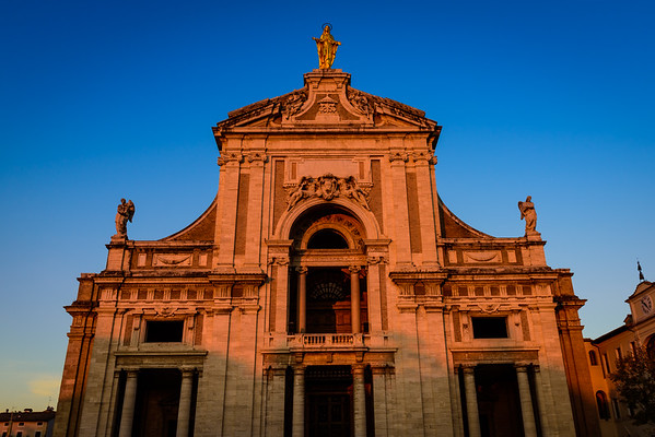 Papal basilica of Santa Maria degli Angeli in the province of Perugia (frazione of Assisi) in deep sunset golden hour. The Porziuncola church is completely contained inside - the basilica was built around the church.