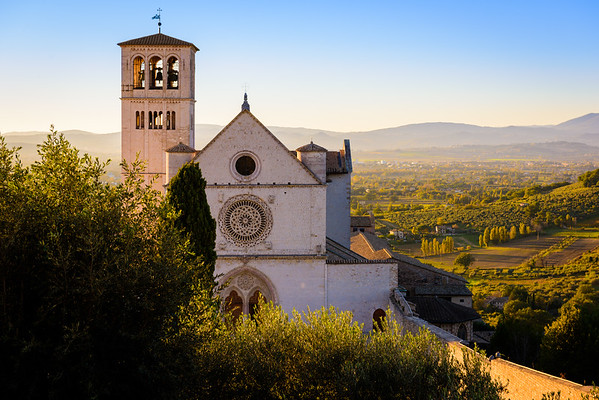 View of the basilica di San Francesco from a hill on a side street in Assisi