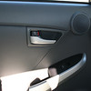 The left rear seat.  It has unlock and lock only for this door, window controls, and a speaker.