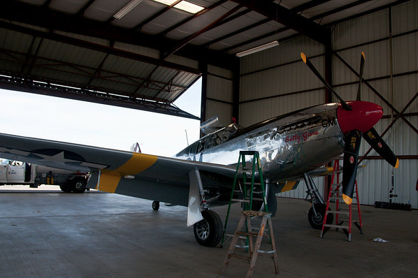 """WWII vintage North American P-51C belonging to the Collings Foundation and used for flight demos and instructions around the country.  The airplane was originally built as a P-51""""B"""" (single seat) and later converted to a """"C"""" (two seater)."""