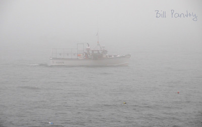 lobster boat in fog off Otter Cliff, Acadia National Park, Maine