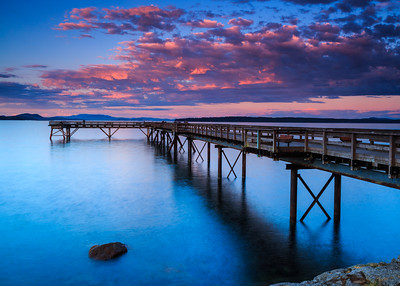 Red cloud sunset at fishing pier