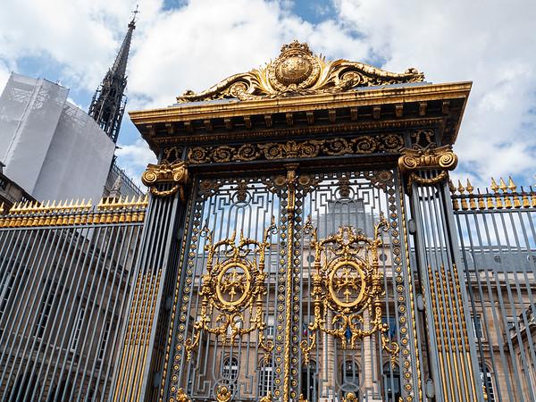 The gates of the Palais de Justice with the spire of Ste. Chapelle | Paris, Île-de-France, France