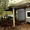 Far side of old garage with trellis. Huge wisteria grew up the front and side of the old garage