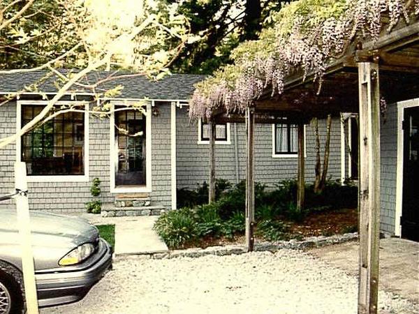 Original garage & orbor w/ very old, large wisteria