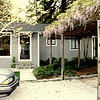 Original garage & orbor w/ very old, large wisteria