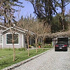 Driveway with old one-car garage & arbor