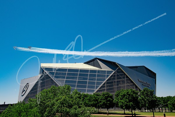 The Blue Angels and Thunderbirds during the America Strong Joint Flyover at Mercedes-Benz Stadium in Atlanta, Georgia, on Saturday May 2, 2020. (Photo by Jim Blackburn/AMB Sports & Entertainment)
