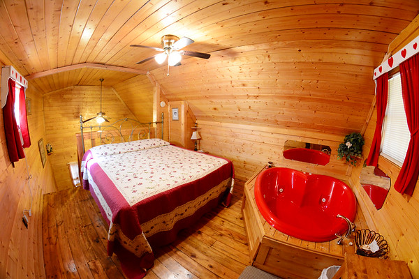 Heart-shaped jacuzzi tub in the bedroom.