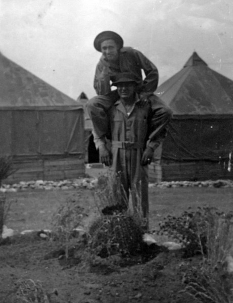 Dad clowning around on shoulders of a soldier, most probably in Ft. Bliss, Texas.