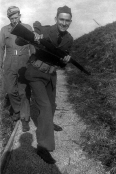 My dad clowning around with rifle, probably in Unalaska.
