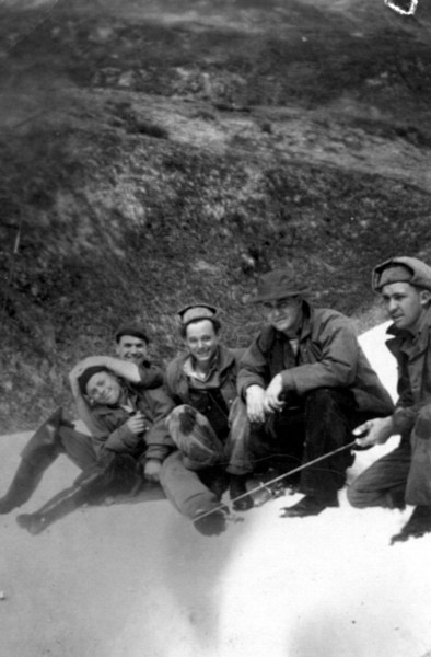 Work crew on the mountain in the snow at Dutch Harbor. My dad, Emon Perdue is on the right.