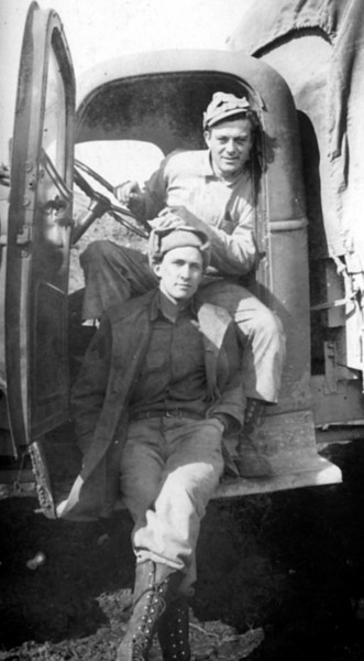 My Dad, Emon Perdue, in front leaning on truck in Dutch Harbor, Aleutians, Alaska during World War II, probably 1941 or 42.