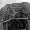 My dad, Emon C. Perdue on right posing with other friends from the 206th Coast Artillery Regiment with two large caliber shells in front of a bunker near Dutch Harbor.