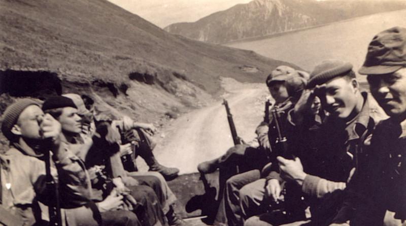 Soldiers on truck near Dutch Harbor in World War II.