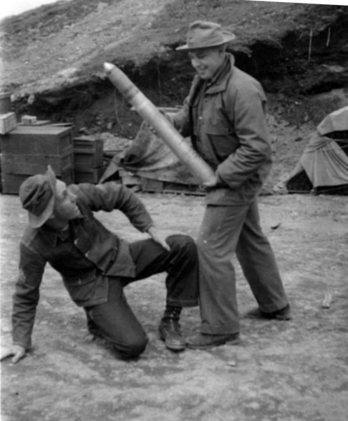 My dad (on left) clowning around with large artillary shell in Dutch Harbor, Alaska. 1941-43