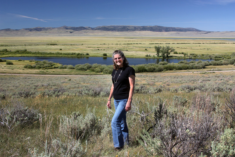 Donna D. Perdue with Shambow Pond in the background at Red Rock Lakes National Wildlife Refuge, MT. Aug 4, 2012.