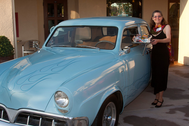 """Ron Warner's '52 Studebaker was on display during the reunion. Donna """"Dilks"""" Perdue is standing in as """"car hop"""". I never had a car hop look so good (or at least so old)."""