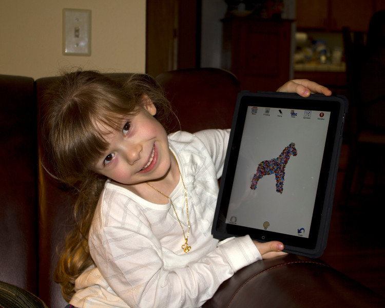 Chloe shows off her latest Cookie Doodle on the iPad. She wants an iPad so she can make virtual cookies all day long!  Thanksgiving Day, 2011, Gilroy, California.