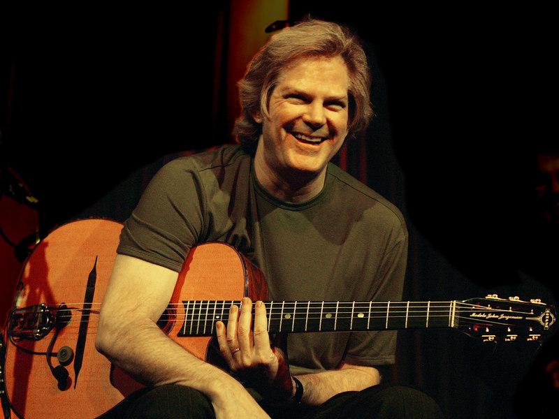 John Jorgenson with guitar in concert in Oregon.