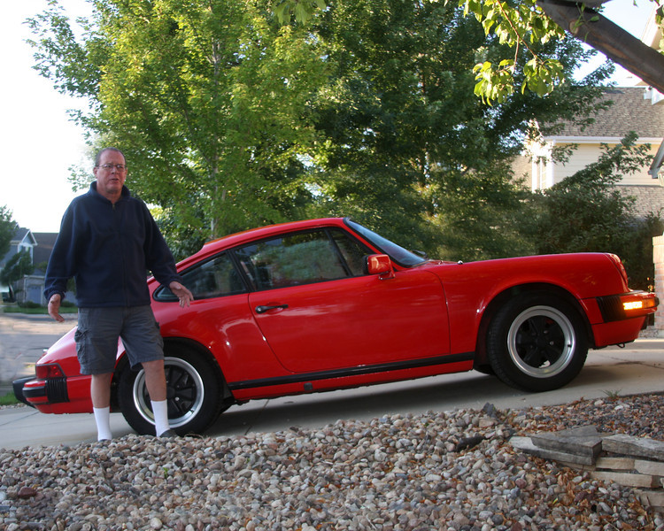 """My friend, Burke Taft, standing next to his 1984  Porche,  the first of the """"Carrera"""" series,  in Lafayette, Colorado.Sep 2011."""