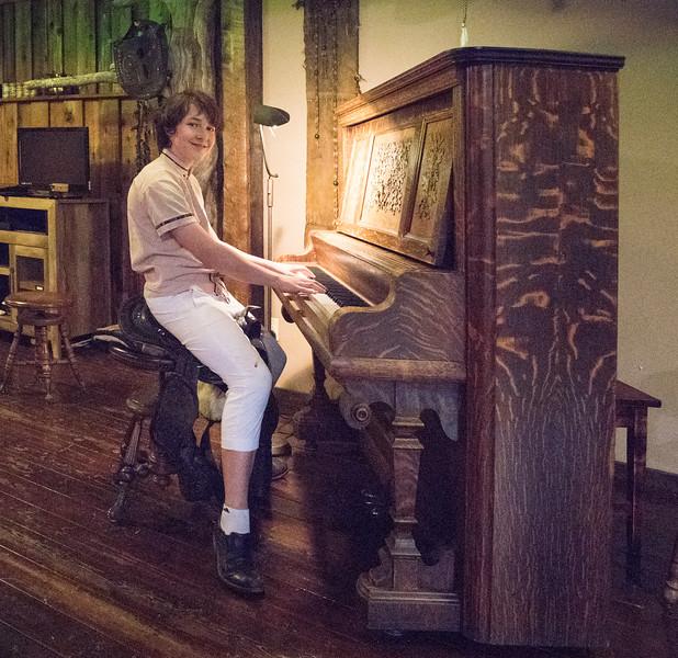 Sasha Grossman playing in the saddle