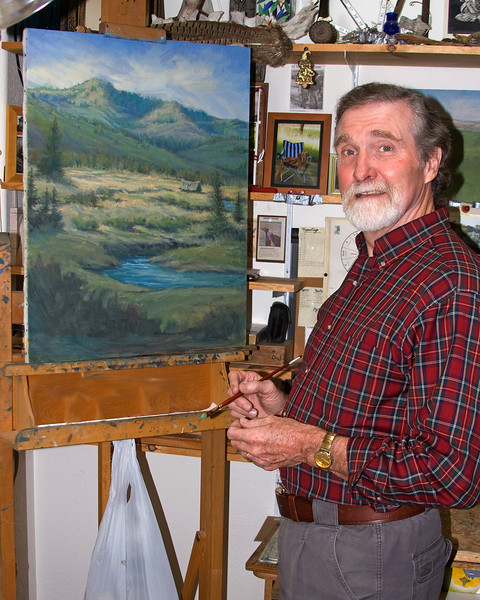 My friend, Joel Price, artist, working on one of his landscapes in his home in Boise, Idaho. October 5th, 2009.