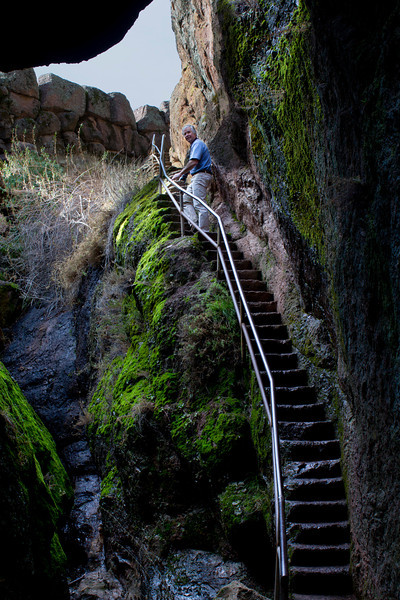 Doug Wenger climbing stairs out of the Bear Gulch Caves at the Pinnacles National Monument, near Hollister, California. Jan 24, 2012.