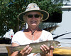 Sue Walker and her recently caught Brook Trout from Henry's Lake. July 22, 2012
