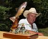 Dean Longgood and an award winning wood carving of a Yellowstone Cutthroat trout. The carving is by Karl K Northrup Sr in Yakima Valley, WA.
