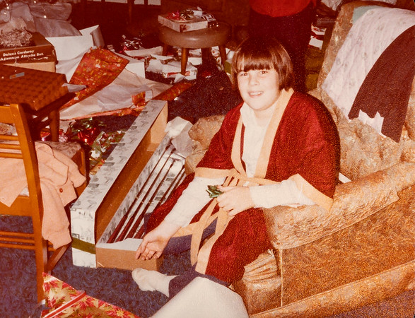 [Greg] Christmas in Roseburg.  I made Greg's bathrobe.  It looks like he got golf clubs for Christmas, undoubtedly from Grandma & Grandpa Reed.  About 1977?