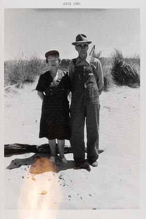 [August 1961. Nanny Oakland & Bub].  This was probably taken in the 50s.  Nanny Oakland with husband Carver (Bub) Hamilton - - - probably at Winchester Bay, OR - where they had a very rustic cabin for fishing and clamming.