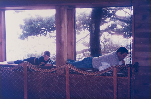 Reading in the crow's nest in Newport, Oregon.