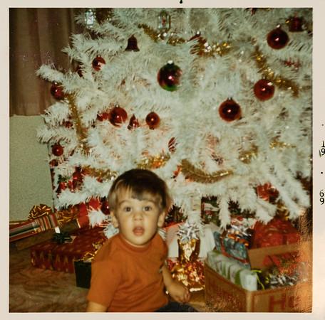 [Greg & our Christmas tree.  What you want grandpa.  I am ready.  Dec 1969.] At Grandpa & Grandma Rains' house at Christmas.