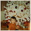 [Greg & our Christmas tree.  What you want grandpa.  I am ready.  Dec 1969.] At Grandpa & Grandma Rains' house at Christmas.