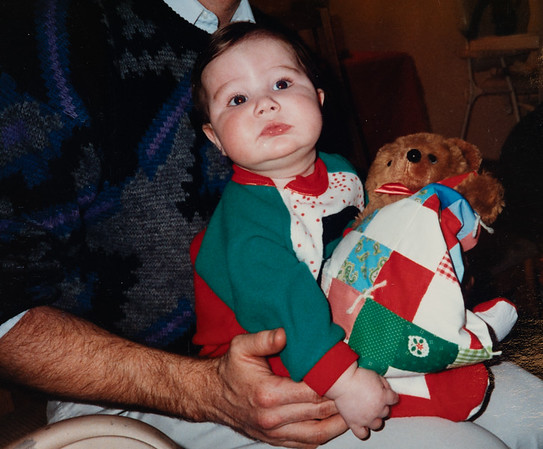 [Michael Andrew Rains 1st Christmas Dec 24, 1990 (5 mos. old).] Being held by his Uncle Mike.