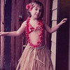 [Jennifer Rains in Hula skirt.  March 1975] Grandma & Grandpa Reed brought you and Julie these outfits from Hawaii.