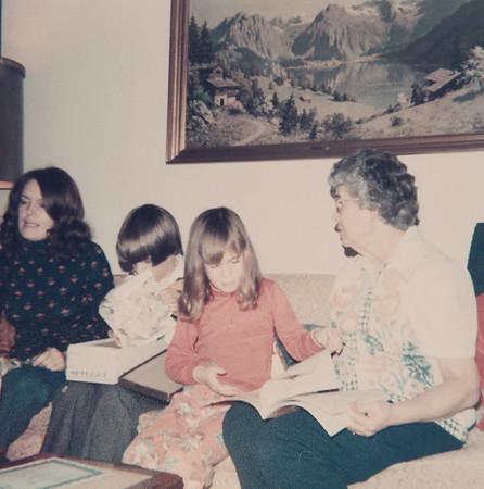 [Jan, Greg + Jennie Rains opening presents at Kate.  Talking to them 12/76]