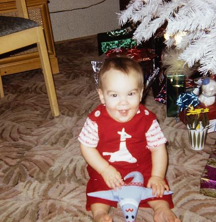 First Christmas.  Grandma Rains made the toy.