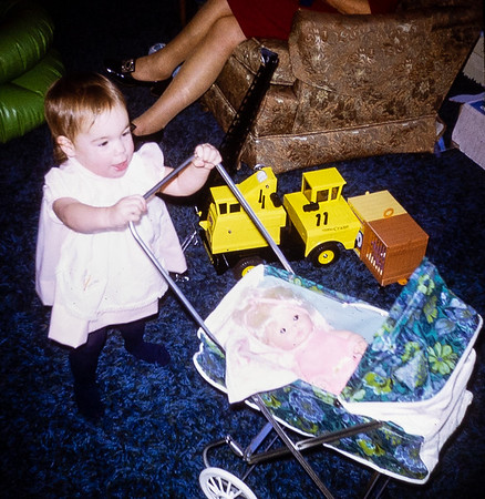 Jehnee loved her doll and baby carriage.
