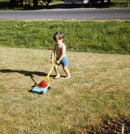 Greg and his lawn mower.  He loved that mower!!