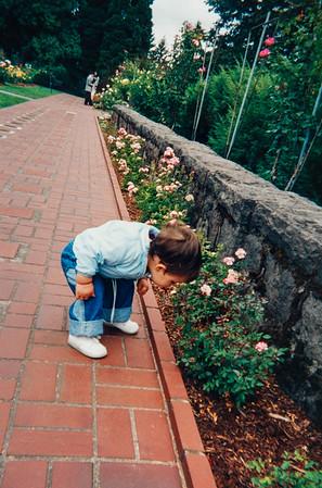 [Smelling the roses at Washington Park]