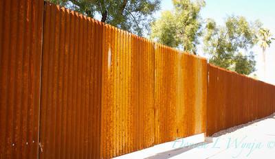 Corrugated rusty metal fencing_5772