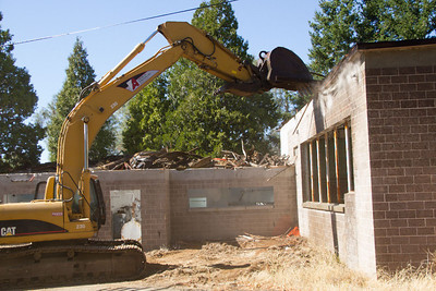 Excavators are the tool of choice for this type of demolition at Mount Umunhum.