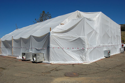 Building 120 tented containment to clean asbestos-containing coating from exterior