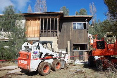 Remediation workers completing exterior remediation at Family Housing building