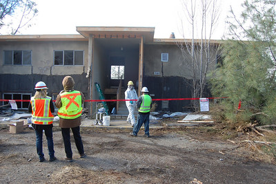 United States Army Corps of Engineers observing progress of exterior stucco remediation at Family Housing building
