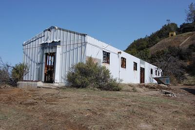 Exterior of Building 119, halfway through remediation